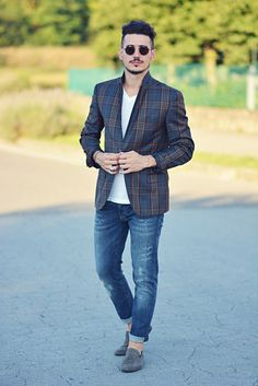 Shop this look on Lookastic:  http://lookastic.com/men/looks/v-neck-t-shirt-and-jeans-and-loafers-and-blazer-and-sunglasses/3349  — White V-neck T-shirt  — Blue Jeans  — Grey Suede Loafers  — Navy Plaid Blazer  — Black Sunglasses