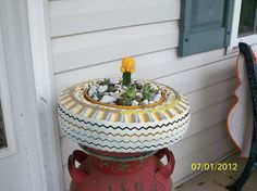 But . . . . . then I decided the front porch would be better if I didn t want to roast it so it ended up on an old milkcan!!
