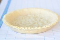 Paleo Pie Crust made with just four ingredients -- almond flour, salt, coconut oil and egg, can cradle fruit, or creamy pie filling. Low-carb, gluten-free.