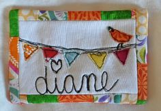 Mini quilted name tag with bird and pennant banner