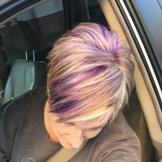 Blonde pixie haircut with purple and fuchsia highlights!