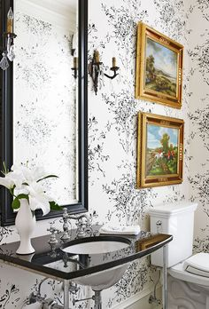 Lovely powder room in black and white with colorful yet traditional art.  Bright, White, and Inviting Family Home - Traditional Home