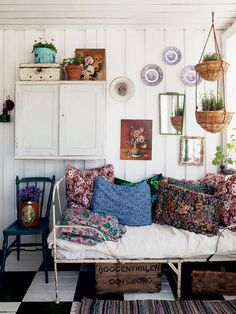 I like the old chippy metal bed frame & floral pillows