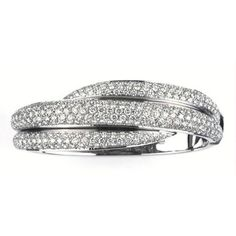 This 18kt white gold criss cross bracelet, from the Gomitolo collection by Damiani, features pavé set diamonds with a total carat weight of 8.24, colour grade H and clarity VVS. Birks $49,250 CA