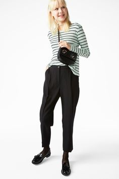 Dressy trousers that are meant to have a casual-chic, slightly oversize fit.