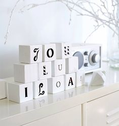 DIY idea: Paint children's wooden blocks and write a Christmas greeting on them.