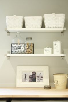 Very cute laundry room decor - love the clothespins in a jar :)