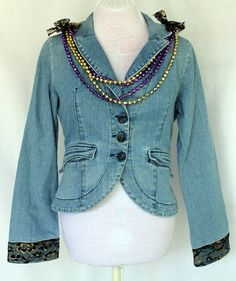 This is my Mardi Gras inspired jacket. This year Mardi Gras (Fat Tuesday) is February 21.  I applied a black and gold lace overlay on the back (I like the hem on this jacket. dcm)