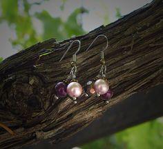 Earrings with bronze  dark purle soft pink Swarovski door deBATjes