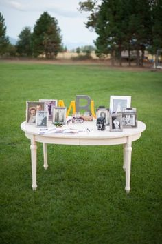 Guest book table with framed family photos. Easy DIY wedding decor.
