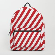 """Designing our premium Backpacks is a meticulous process, as Artists have to lay out their artwork on each component. One size fits all men and women, with heavy-duty construction that's able to handle the heavy lifting for all your school and travel needs. - Standard unisex size: 17.75"""" (H) x 12.25"""" (W) x 5.75"""" (D) - Crafted with durable spun poly fabric for high print quality - Interior pocket fits up to 15"""" laptop - Padded nylon back... Red Backpack, Fashion Backpack, Back To School Backpacks, D Craft, One Size Fits All, Laptop, Stripes, Unisex, Pocket"""
