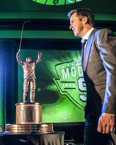 Mike Modano with the Mike Modano Trophy, which will be awarded annually to the Stars player who finishes as the regular season leader in poi. Stars Hockey, Hockey Teams, Ice Hockey, Lord Stanley Cup, Mike Modano, Moving To Dallas, Hockey Boards, Sports Fanatics, The Mike