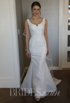 "Brides.com: Peter Langner - Spring 2014. ""Yumi"" mermaid wedding dress with geometrical folds and a scoop neck, Peter Langner."