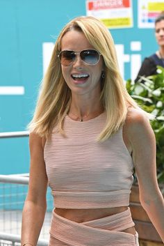 Amanda Holden was back to her lingerie-shunning best on Tuesday as she arrived at the UK TV Live launch in London alongside stars including Lily Cole and Sir David Attenborough Bikini Beach Pics, Bikini Pictures, Amanda Holden, Hampshire, Bathing Suit Dress, Lily Cole, Britain Got Talent, Uk Tv, Pink Crop Top