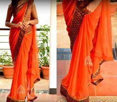 Orange saree with black and gold banarasi border.