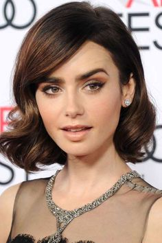 Lily Collins is no stranger to switching-up her beauty look: long hair, short hair, pink lips, black... - Provided by Harper's Bazaar