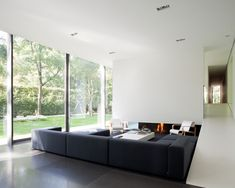 Villa Roces by Govaert & Vanhoutte  Wall_1 modular seating system by Piero Lissoni for Living Divani