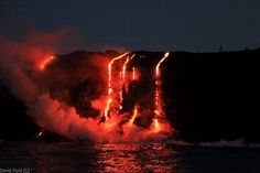 Kilauea Volcano, on big island of Hawaii, Lava reaches the ocean sizzling, smelling like sulfur on July 28, 2016.