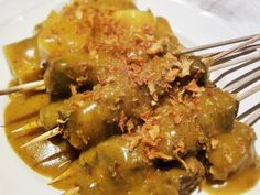 Beef satay, Padang (Indonesia) style https://worldofeleonore.wordpress.com/2013/07/10/beef-satay-padang-indonesia/