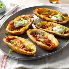 Bacon Cheddar Potato Skins Recipe -I fill my restaurant-worthy baked potato boats with cheese, bacon and a dollop of sour cream. Have them at lunch, snack time or cocktail hour. —Trish Perrin, Keizer, Oregon