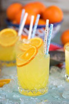 Famous Orange Crush Cocktail on a blue background with oranges in the background, and blue and white strawx. the popular orange crush cocktail! Blue Cocktails, Vodka Drinks, Summer Cocktails, Triple Sec Cocktails, Beverages, Drinks Alcohol, Cold Drinks, Orange Crush Cocktail, Champagne Cocktail