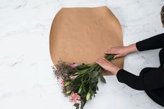 There's really something about brown paper packaging that looks down-to-earth, personal, and non-commercial. That's why it lends itself beautifully to flowers. The last thing you want