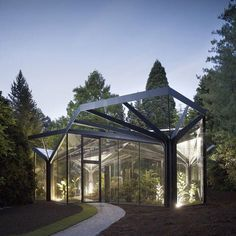 Greenhouse of steel trees in Switzerland by Buehrer Wuest Architekten.