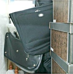 5x3. Lots of Boxes, Lots of Luggage that look full, Outdoor Wooden Tarps with wooden accessory. #StorageAuction in Vancouver (E290). Lien Sale.