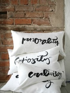 Minimalist hand-painted pillows with human qualities in gorgeous script.  (Via La Bonne Vie, from zsazsabellagio.)