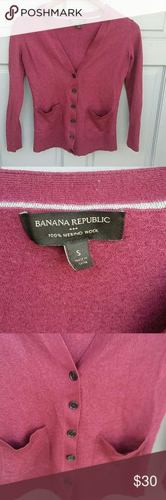 """Banana Republic Merino Wool Cardigan Excellent condition, worn once. Size small. 100% Merino Wool. Button up front with two front pockets. V neck. Burgundy color. Appx Measurements: -Length 22"""" -Bust 16"""" -Sleeves 20"""" Banana Republic Sweaters Cardigans"""