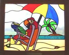 "HA!  A Parrothead stained glass piece! ... This is hanging in Margaritaville in Key West, FL.  Framed it measures 17.5"" x 21.5""."