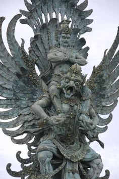 A sculpture in Bali Indonesia of Vishnu riding a Garuda, a large mythical bird-like creature that appears in both Hindu and Buddhist mythology.