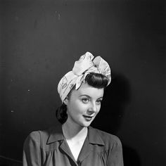 "Nothing says ""classy dame"" like a beautifully-tied scarf turban…complete with oversized bow!"