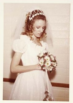 A beautiful 1970's bride. Love the bouquet!