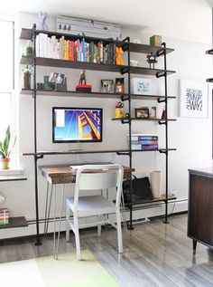 Piped shelving >> Joe & Brad's Small Space with Big Style << www.apartmenttherapy.com