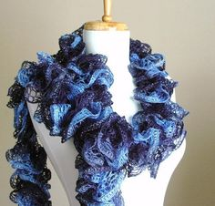 This gorgeous soft hand knit scarf was knit using a soft lacy multicolor blue ribbon yarn with just a hint of sparkle on the ruffle edges See photo Measures approximately Hand Knit Scarf, Knit Cowl, Cowl Scarf, Chunky Scarves, Knitted Scarves, Red And Grey, Dark Blue, Black, Ribbon Yarn