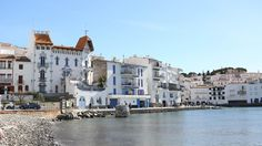 A destination guide of unique places to visit for the world traveler. Cadaques Spain, Spain Travel Guide, Fishing Villages, The Province, Beautiful Architecture, Local Artists, World Traveler, New York Skyline, Places To Visit