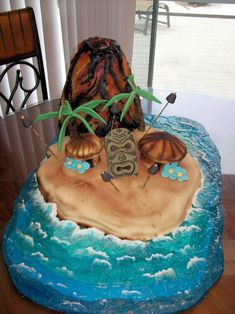 Volcano Cake This was a cake I did for a Luau Party. The Volcano was erupting smoke when we added dry ice and water. Volcano was made of...