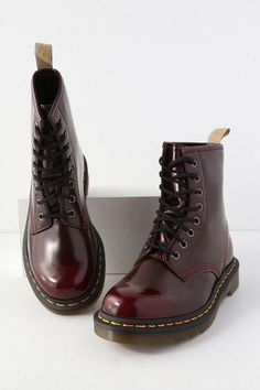 "You can't get more OG than the Dr. Martens 1460 Pascal Cherry Red Vegan Leather 8-Eye Boots! Patent cambridge brush 100% vegan leather shapes the classic 1460 pascal design with a rounded toe, 8-eye lace-up upper, and gunmetal hardware. Chunky, air-cushioned sole with yellow stitching and no-slip finish. Branded pull tab loop at back. Fit: This garment fits true to size. 1. 5"" rubber heel. Cushioned insole. Rubber sole has nonskid markings. 100% vegan frie #drmartensboots"