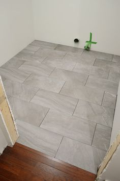 Young House Love - One young family + one old house = love. (Love this gray tile floor ) Room Tiles, Bathroom Floor Tiles, Bathroom Grey, Bathroom Tile Patterns, Laying Tile Floor, Tile Floor Patterns, Entryway Tile Floor, Tile Layout Patterns, Bathroom Ideas