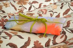 spray painted newspaper as gift wrap