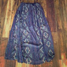 Xhilaration Slip Maxi Skirt Small Worn a handful of times and is a little too small in the hips for me. Lined underneath until knees, Then the fabric is sheer. There are two slits from the bottom to the knee. Very cute, very boho chic. Xhilaration Skirts Maxi