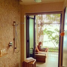 Balcony shower overlooking the water.