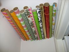 Wrapping paper storage solution--use wire and store it in a closet near the ceiling!