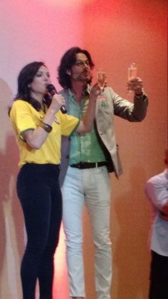 Awesome Lana and Fred holding wine toasting the awesome Brazilian EvilRegals/Oncers possibly singing during Lana's panel at the EverAfterCon in Rio de Janeiro Brazil Sunday 6-28-15