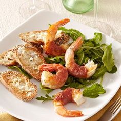 Prosciutto-Wrapped Shrimp with Arugula Salad for Two Recipe ~ This recipe for jumbo shrimp wrapped in thin strips of prosciutto and served on a lemony bed of arugula is a practically effortless recipe for two. Wrap your shrimp and make the dressing ahead of time, and you'll have dinner on the table even faster. Serve with toasted whole-wheat baguette sprinkled with Parmesan cheese. #shrimp #recipes for #dinner