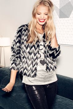 Make a dramatic entrance with a bold faux-fur jacket in graphic black & white. | Party in H&M