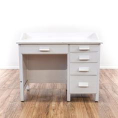 This shabby chic desk is featured in a solid wood with white paint finish. This desk has 5 drawers, carved handles and a rail top. Great as a kids homework desk! #shabbychic #desks #writingdesk #sandiegovintage #vintagefurniture