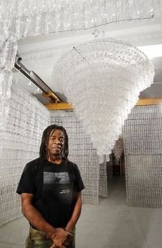 """Artist Willie Cole's exhibit """"From Water to Light"""" features two chandeliers in rooms made of recycled water bottles. It runs through May 31 at the Prospect Street Fire Station Gallery in Newark. Ed Murray/The Star-Ledger Empty drinking water bottles..."""