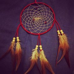 Red faux suede trim dream catcher, beige beaded web, rooster feathers and wooden bead finish 15cm diameter dreamcatcher hand made on Etsy, £9.00